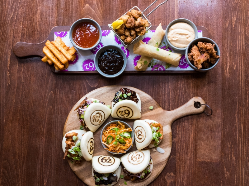 taster board with Salt & Pepper Calamari, Rainbow Spring Rolls Halloumi Fries, Buttermilk Chicken Bites, steamed bao buns